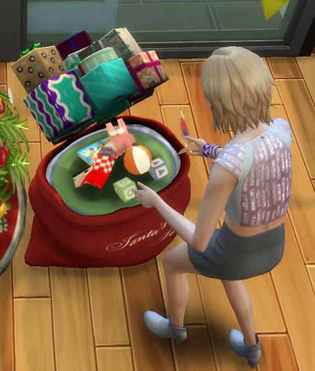 Simsworkshop: Santas Sneak Peek Sack toybox by BigUglyHag