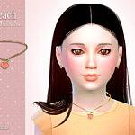 Peach Child Necklace by Suzue